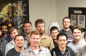 Andrew Reisse (shown in the center withthe tan shirt) with the Oculus VR Team