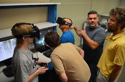Andrew Reisse (shown on the right with the yellow shirt) and others testing out the Oculus Rift